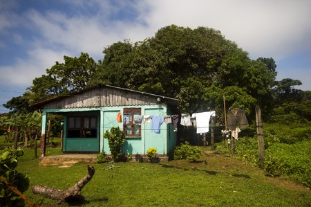 house typical architecture zinc roof shanty residence with laundry hanging and barbed wire fence corn island nicaragua tropical jungle Stock Photo - 4225456