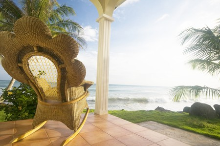 handmade wicker rocking chair on patio luxury resort hotel caribbean sea rural big corn island nicaragua central america photo