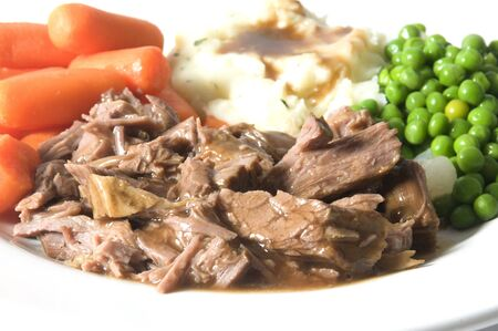 pot roast dinner green peas baby carrots mashed potatoes gravy Stock Photo - 4403258