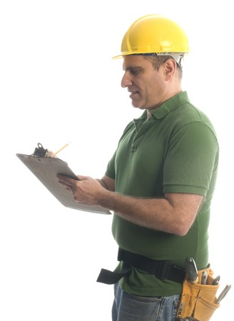 contractor handyman repair man smiling writing an estimate of price home owner with hard hat helmet hammer and tool belt photo