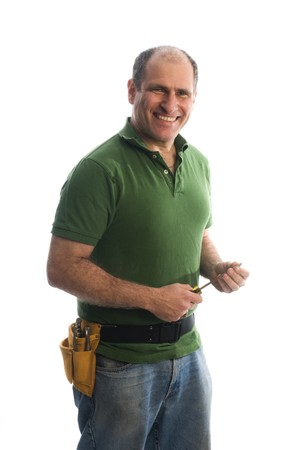 contractor handyman repair man smiling writing an estimate of price home owner with hard hat helmet hammer and tool belt Stock Photo