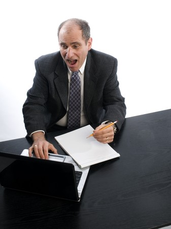 excited senior executive in office desk middle age man photo