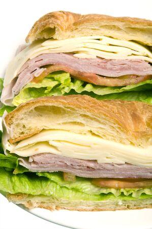 gourmet ham swiss cheese sandwich croissant bread white background