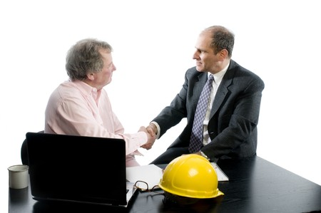 banker: business management senior executives client shaking hands in office retired older men architect builder construction designer client Stock Photo