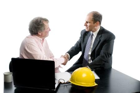 business management senior executives client shaking hands in office retired older men architect builder construction designer client Stock Photo