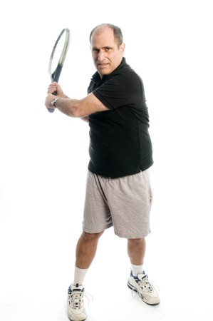 babyboomer: happy senior middle age man demonstrating tennis backhand athletic staying healthy with exercise