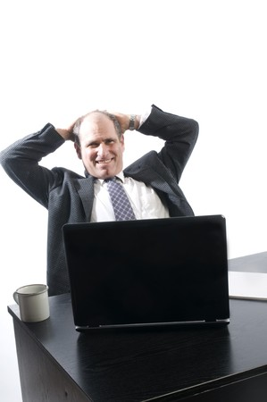corporate business senior executive relaxing at desk in office management photo