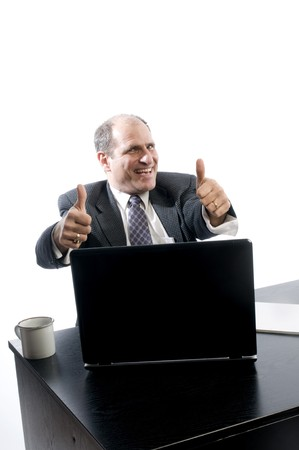 excited senior management executive at desk with positive successful sign thumbs up photo