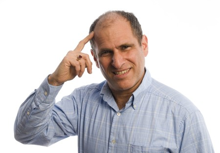 handsome middle age man with hand to head questioning and not understanding something