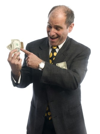 doctor giving dollars: handsome middle age business executive with wad of cash wealthy Stock Photo