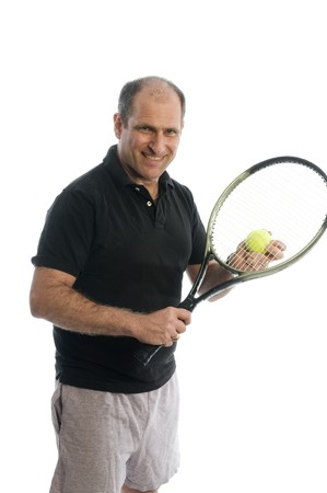 happy senior middle age man demonstrating tennis stroke athletic staying healthy with exercise Stock Photo