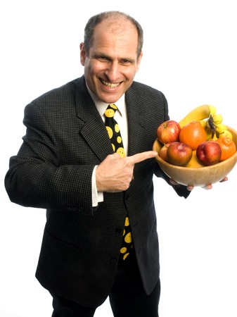 funny happy healthy senior middle age man with bowl of fresh fruit photo