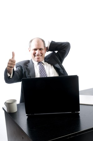 senior executive business corporate man at desk makin positive point about job on computer photo