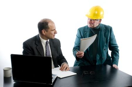 partners client manager designer architect business plans construction office corporation setting hard helmet protective gear photo