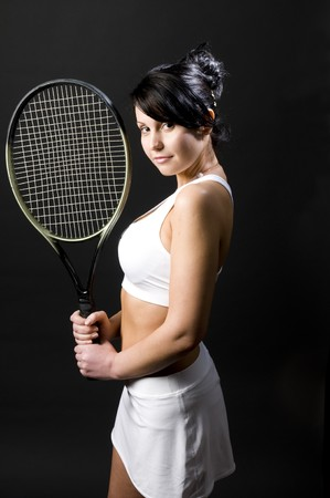 pretty sexy young female woman tennis player tennis clothes and racket photo