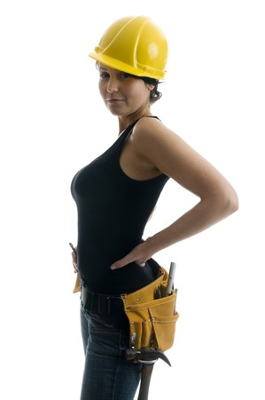 pretty sexy young woman construction worker contractor with tools and hard hat photo