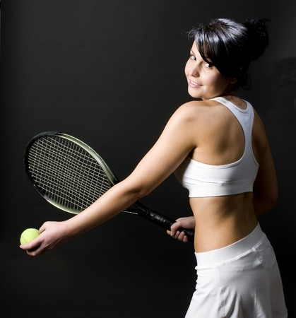 pretty sexy young female woman tennis player tennis clothes and racket Stock Photo - 4577382