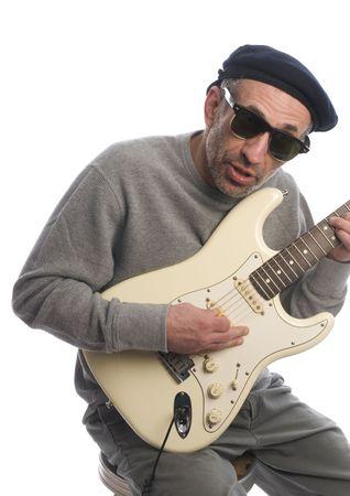 babyboomer: aging baby-boomer old senior man musician playing guitar french beret hat