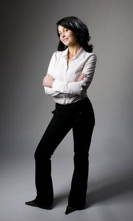 jeans apretados: sexy joven modelo plantean el retrato de empresarial de estudio