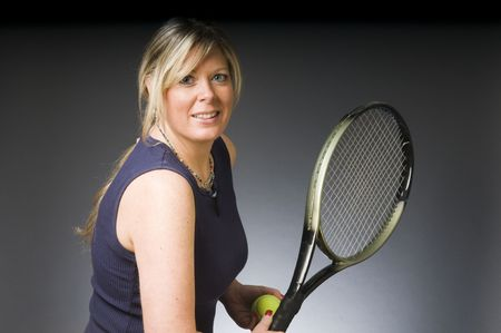 age forty: happy smiling female tennis player with racquet and ball healthy lifestyle concept Stock Photo