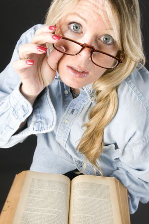 pretty attractive blond woman reading book eyeglasses photo