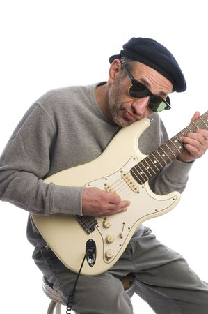 aging baby-boomer old senior man musician playing guitar french beret hat photo