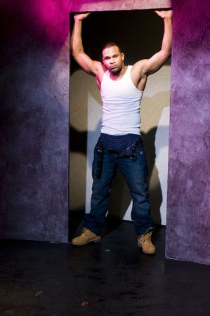 thespian: young black male african american actor perfomer on stage portrait theater lights