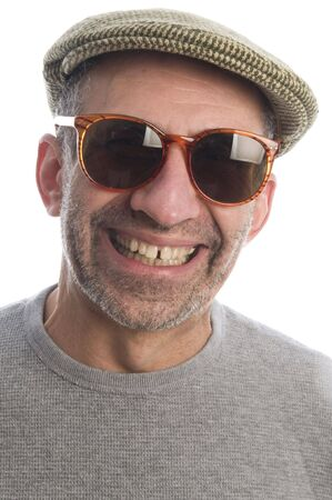 middle age senior man wearing artist scottish tweed  hat macro close up distorted large nose face retro sunglasses expression  photo