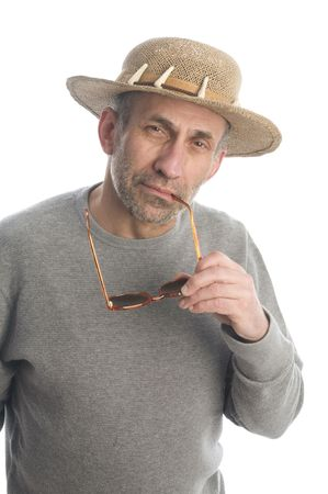 quizzical: middle age senior man baby boomer wearing straw hat with quizzical expression look on face