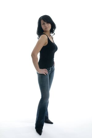 shapely pretty young woman smiling with attitude in tight jeans isolated Banco de Imagens