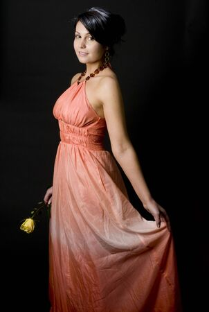 full length portrait of sexy young woman in formal clothes dress bride with yellow flower photo