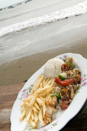 chili's restaurant: mixed seafood kabob lobster shrimp fish octopus photographed seasdie beach view in San Juan del Sur Nicaragua Central America