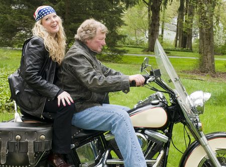 pretty woman and handsome man on classic vintage motorcycle