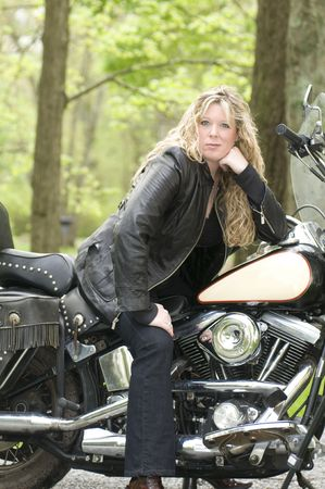 retro woman: pretty woman on classic vintage motorcycle