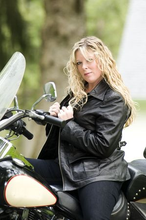 pretty woman on classic vintage motorcycle