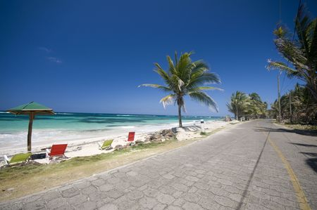 corn island: the seaside malecon highway next to sallie peachie beach on the caribbean sea big corn island nicaragua central america