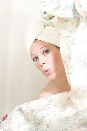 pretty woman surised expression while taking a bath or shower in the bathroom Stock Photo