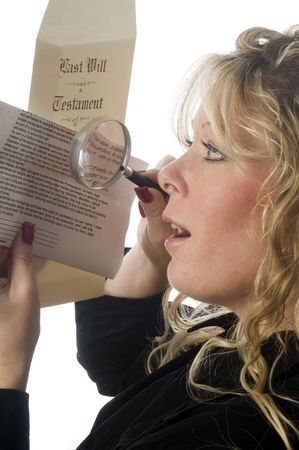 woman lawyer inspecting an important document last will with surprised look on face