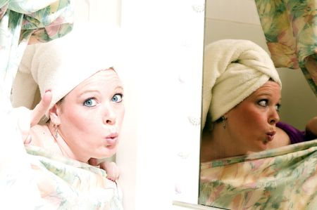 mirror image: pretty woman surprised in shower with mirror image