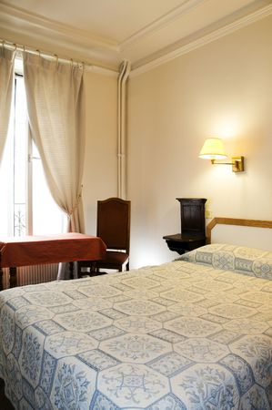 compostion: typical two star hotel room paris france in the latin quarter vertical composition