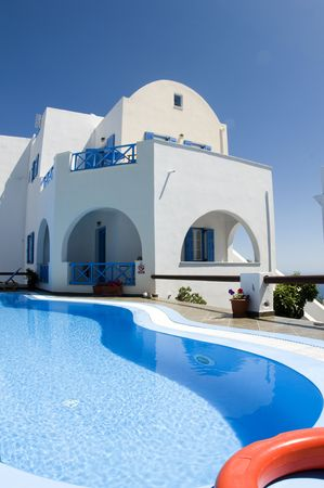 cyclades: swimming pool at luxury imerovigli greek island hotel with cyclades styel arched architecture on island of santorini greece in the mediterranean sea Stock Photo