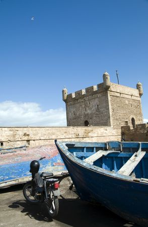 skala: the protective citadel by the harbor skala du port with fishing boats in essaouira morocco africa