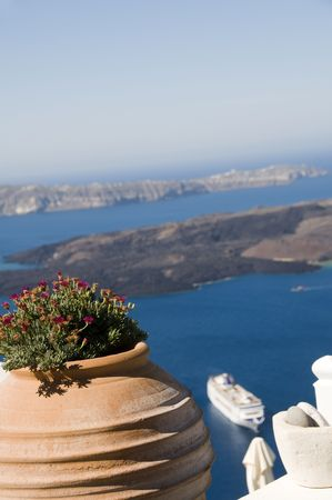 flower plant vase view from deck over caldera to volcanic islands of santorini with cruise ship from imerovigli Stock Photo - 4989363