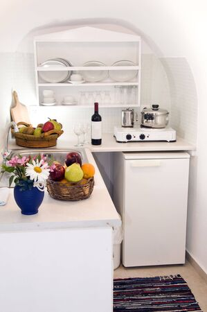 kitchenette: kitchen in maisonette apartment in the greek islands santorin town of oia cave house