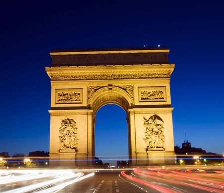 triomphe: arc de triomphe arch of triumph at night with car streaks in the center of the Place Charles de Gaulle also known as Place del Etoile in Paris France on the Champs-Elysees Stock Photo