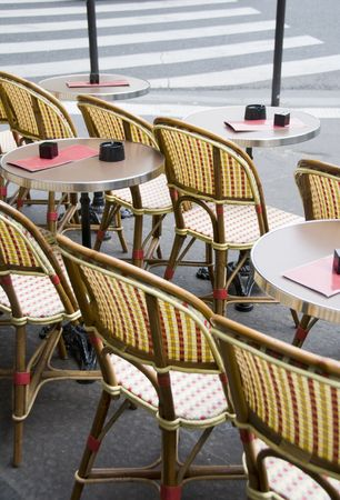 round chairs: typical generic outdoor cafe setting paris france with tables and chairs on the sidewalk