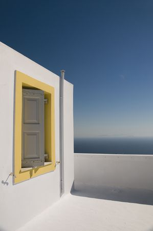 thira: classic whitewashed stucco greek island cyclades architecture overlooking the mediterranean sea in imerovigli santorini island thira greece