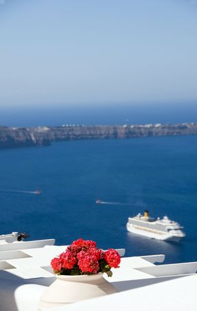santorini caldera: santorini caldera view of aegean sea and volcanic islands with cruise ship in harbor from imerovigli
