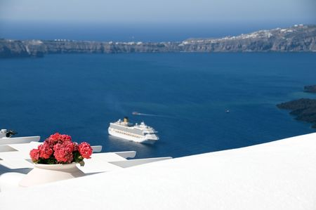 aegean: santorini caldera view of aegean sea and volcanic islands with cruise ship in harbor from imerovigli  i thira in greek islands