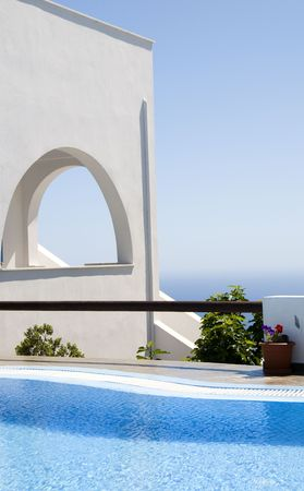 cyclades: greek island cyclades whitewashed architecture with swimming pool and view of mediterranean in imerovigli santorini greece